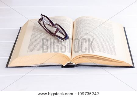 glasses and book on the white background