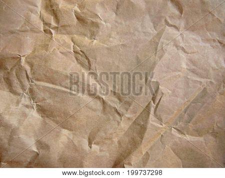 Rumpled brown cardboard paper. Paper texture. Paper background.