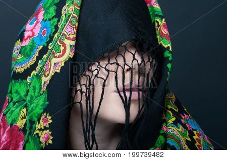 Female Model With Face Covered By Scarf