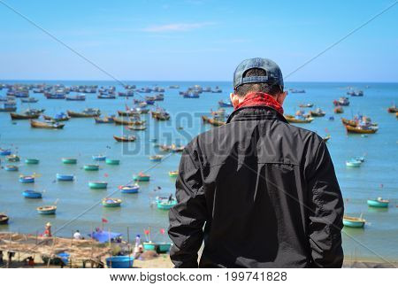 Asian Tourist Man Looking At The Sea