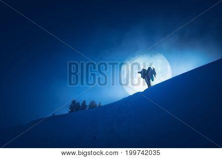 Photographer Against Full Moon