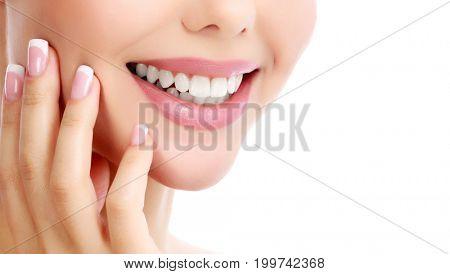 Closeup shot of beautiful female smile, white background.