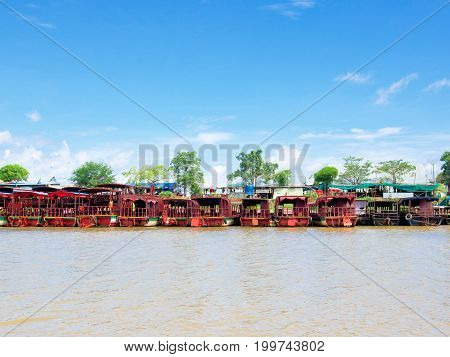 Siem Reap Cambodia - October 29 2016: Tourist boats are at anchor at the bank of Tonle Sap the large freshwater lake in Siem Reap Cambodia.