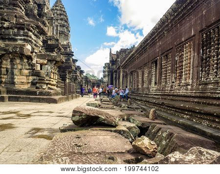 Siem Reap Cambodia - October 30 2016: Angkor Wat the 12th century temple which is situated in Siem Reap Cambodia and the UNESCO World Heritage site visited by various tourists.