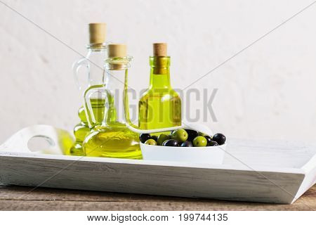 the olive oil on the wooden table