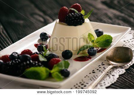 Italian dessert - panna cotta with berries.