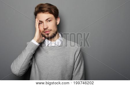 lifestyle, business and people concept: Businessman stressed pressure headache worry isolated on grey background