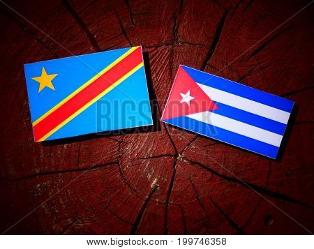 Democratic Republic Of The Congo Flag With Cuban Flag On A Tree Stump Isolated