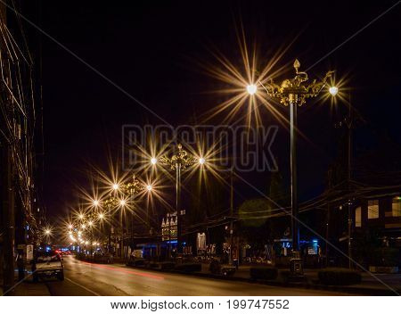 Night City Life: Road And Street Lamps, Retro Style. Small Town Phang Nga, Thailand