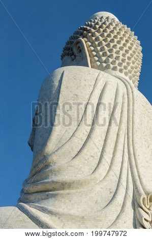 Back View Of The White Marble Statue Of Big Buddha On Blue Sky Background