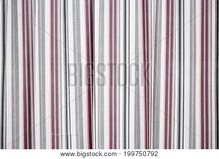 several colored stripes on a white fabric