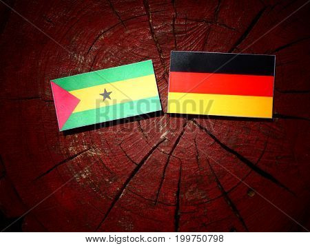 Sao Tome And Principe Flag With German Flag On A Tree Stump Isolated