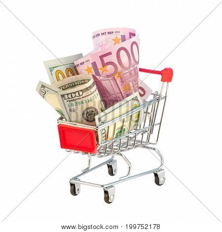 Euro and dollar bills in shopping cart isolated
