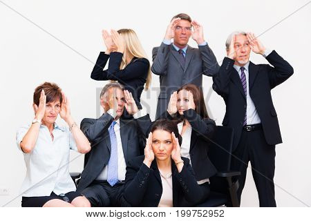 blinkered business team looking in the different directions, each with his or her own goals. everyone is concerned with only the personal perspective on things and you can't expect much teamwork here.