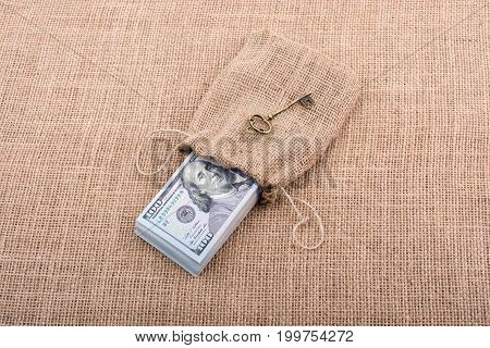 Retro Key And Bundle Of Us Dollar In A Sack