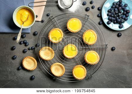 Cooling rack with delicious crispy tarts on table