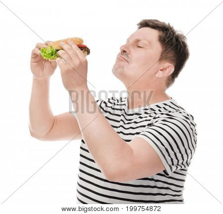 Overweight man with burger on white background. Diet concept