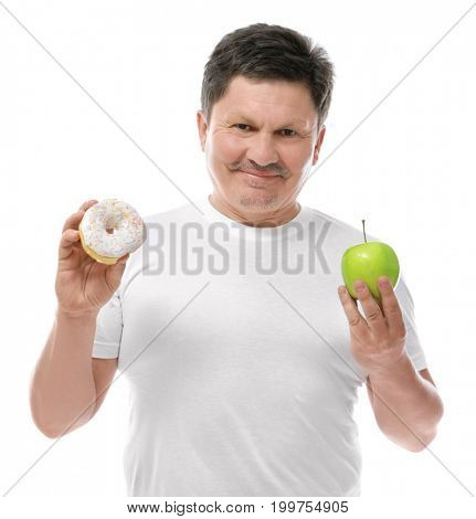 Overweight man with apple and donut on white background. Diet concept