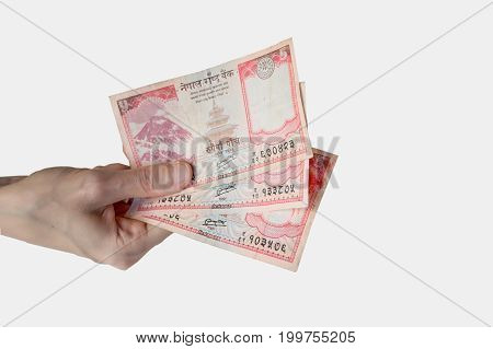 Woman Holding Fifteen Nepal Rupees Notes In Her Hand