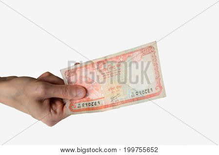 Woman Holding A Twenty Nepal Rupees Note In Her Hand