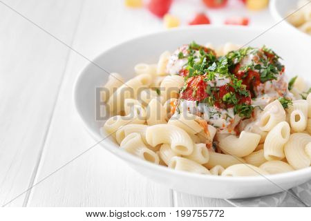 Plate with delicious pasta and turkey meatballs on white wooden table