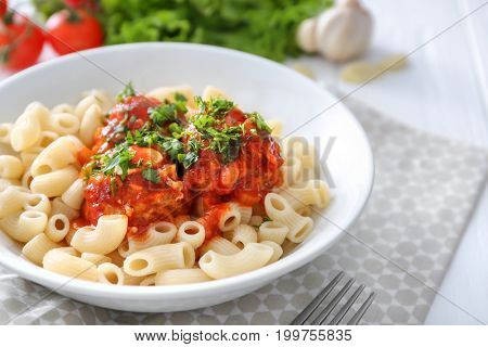 Plate with delicious pasta and turkey meatballs on table