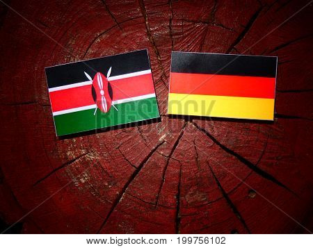Kenyan Flag With German Flag On A Tree Stump Isolated