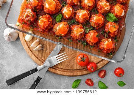Delicious turkey meatballs in glass casserole dish on table