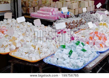 Different tasty Turkish delight at market