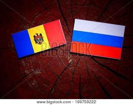 Moldovan Flag With Russian Flag On A Tree Stump Isolated
