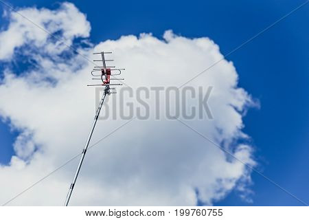 outdoor digital television antenna against blue sky