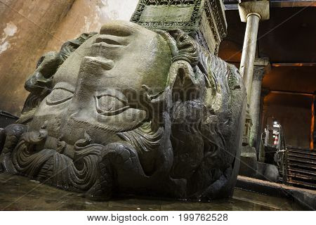 Head of the Medusa Gorgon in the underground tank Basilica Istanbul Turkey