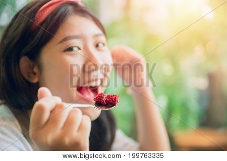 eating cake. cute asian young pritty tubby women eat dessert in cafe.