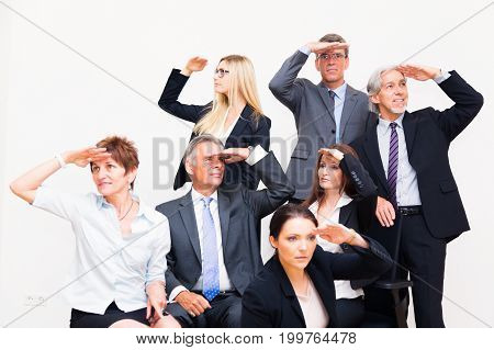 business team looking in the different directions, each with his or her own goal and strategy.