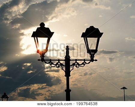 Beautiful lantern against the sun at sunset in Sochi on the sea