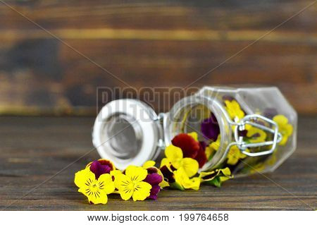 Mothers Day card with pansy flowers on wooden background