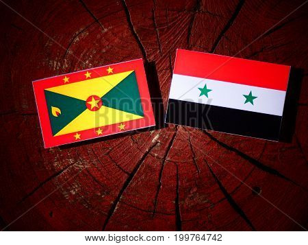 Grenada Flag With Syrian Flag On A Tree Stump Isolated