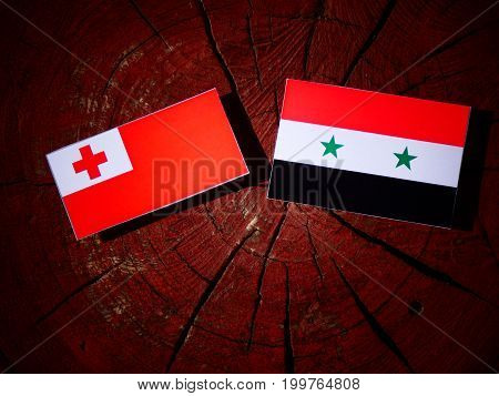 Tonga Flag With Syrian Flag On A Tree Stump Isolated