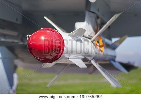 Russian bomber close up. Rocket on aircraft wing. Bombing aircraft