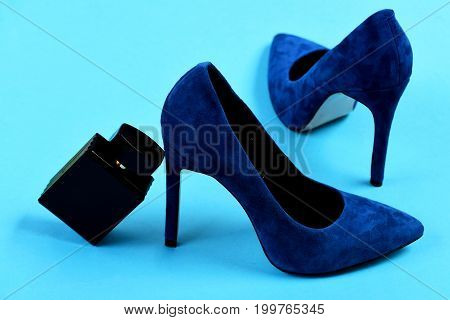 Fashion And Scent Concept: Blue Shoes And Perfume Bottle