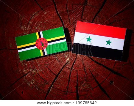 Dominica Flag With Syrian Flag On A Tree Stump Isolated