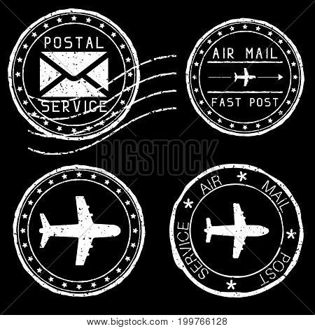 Mail stamps for envelopes. White vector illustration on black background