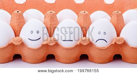 Mood Concept of eggs with different smilies
