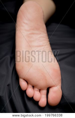 body part. closeup women feet on back background