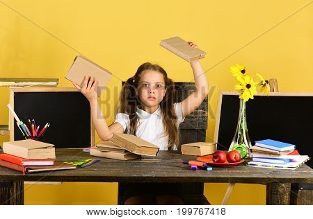 Girl Sits At Wooden Desk With Colorful Stationery, Flowers