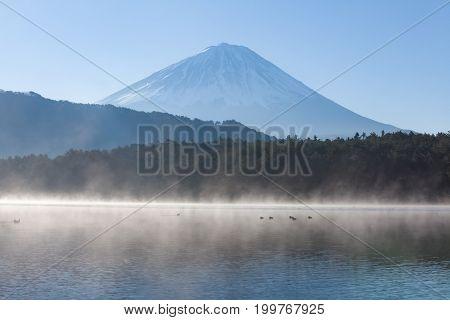 Lake Saiko with morning fog and Mt.Fuji in winter season