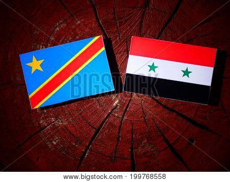 Democratic Republic Of The Congo Flag With Syrian Flag On A Tree Stump Isolated