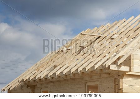 View on New wooden rafter framing - Poland.