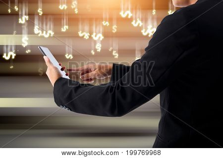 Businessman hands on smartphone and rain of money dollar with modern dark background concept of make money from business online.