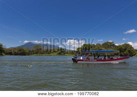 Islets of Granada Nicaragua - April 3 2014: Passenger boat in the Lake Nicaragua taking passengers between the islets in the Islets of Granada Nicaragua